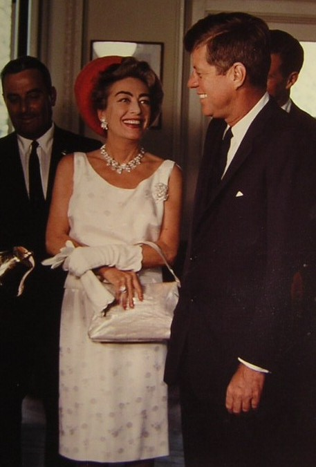 Joan Crawford laughing at a remark made by President Kennedy in the Oval Office, May 3, 1963.