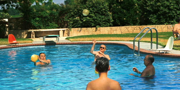 President Johnson engages some of his aides and advisers in a game of pool volleyball.
