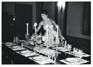 A popular image of Jacqueline Kennedy just months after her marriage, as she lights candles for the first dinner party she hosted with her husband, with guests including his U.S. Senate colleague John Sherman Cooper (Kentucky - R).